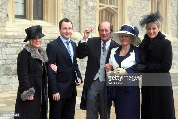 Presenter Fred Dinenage who was made a Member of the British Empire with daughter Sarah son Chris wife Beverley and daughter Caroline after an...