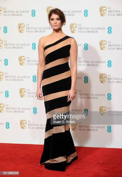 Presenter Gemma Arterton poses in the press room at the EE British Academy Film Awards at The Royal Opera House on February 10 2013 in London England