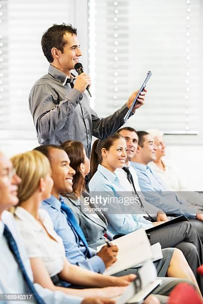 Presenter giving a public speech.