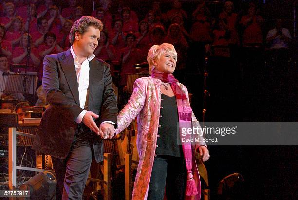 TV presenter Gloria Hunniford and singer Michael Ball are seen on stage at the 'Night of 1000 Voices' at The Royal Albert Hall on May 1 2005 The...