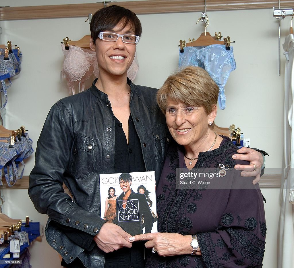 Presenter Gok Wan (L) poses with Rigby and Peller owner June Kenton before signing copies of his new book from the TV series 'How to Look Good Naked' at Rigby and Peller, Conduit Street on April 25, 2007 in London, England.