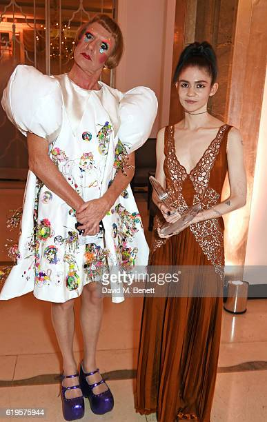 Presenter Grayson Perry and Musician of the Year winner Grimes attend the Harper's Bazaar Women of the Year Awards 2016 at Claridge's Hotel on...