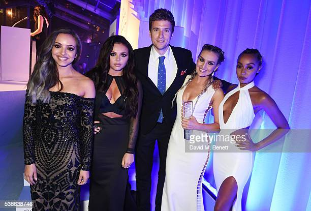 Presenter Greg James poses with winners Jade Thirlwall Jesy Nelson Perrie Edwards and LeighAnne Pinnock of Little Mix attend the Glamour Women Of The...