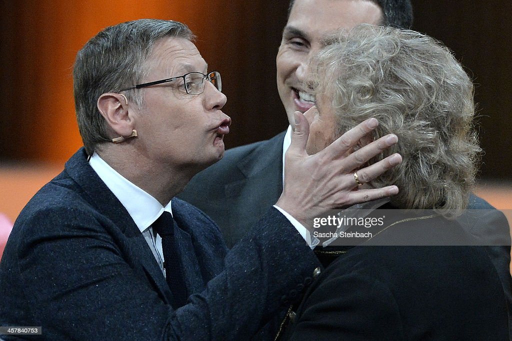Presenter Guenther Jauch tries to kiss Thomas Gottschalk during the taping of the anniversary show '30 Jahre RTL - Die grosse Jubilaeumsshow mit Thomas Gottschalk' on December 18, 2013 in Huerth, Germany.