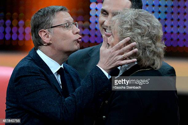 Presenter Guenther Jauch tries to kiss Thomas Gottschalk during the taping of the anniversary show '30 Jahre RTL Die grosse Jubilaeumsshow mit Thomas...