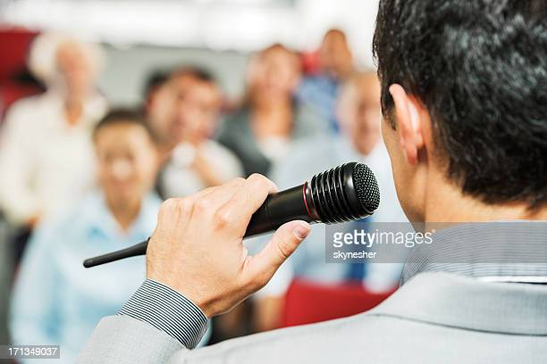 Presenter having a public speech.