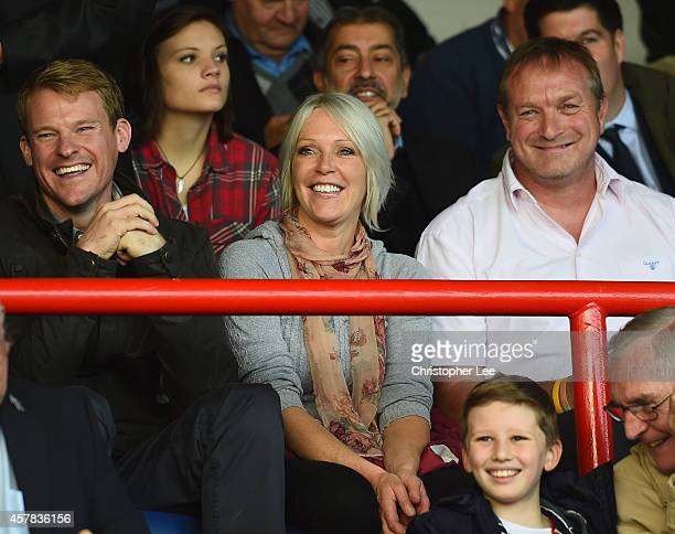 Presenter Helen Chamberlain with friends watch the match during the FA Cup Qualifying Fourth Round match bteween Aldershot Town and Torquay United at...