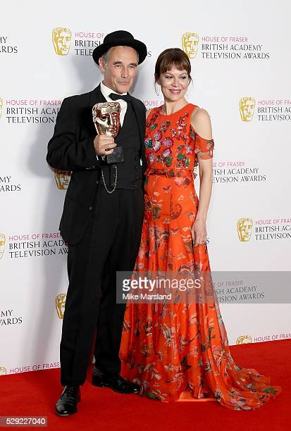 Presenter Helen McCrory and winner Mark Rylance pose with his Best Actor award in the winners room at the House Of Fraser British Academy Television...