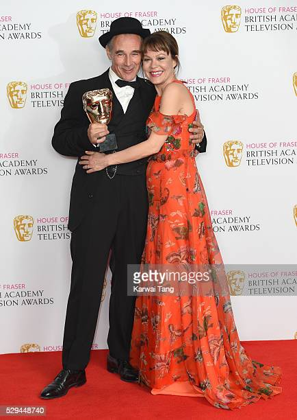 Presenter Helen McCrory and winner of the Best Actor award Mark Rylance pose in the winners room at the House Of Fraser British Academy Television...