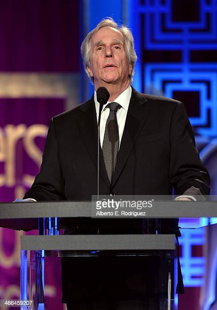 Presenter Henry Winkler speaks onstage during the 2014 Writers Guild Awards LA Ceremony at JW Marriott at LA Live on February 1 2014 in Los Angeles...