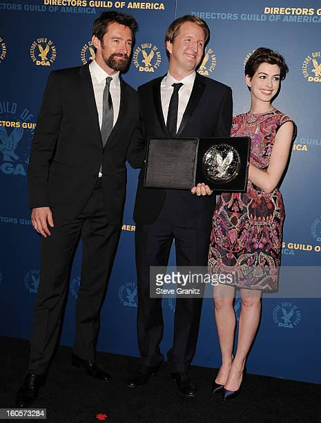 "Presenter Hugh Jackman Director Tom Hooper recipient of the Feature Film Nomination Plaque for ""Les Miserables' and presenter Anne Hathaway pose in..."