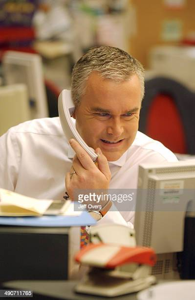Presenter Huw Edwards in the BBC Newsroom
