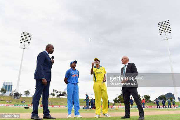 Presenter Ian Bishop captain Prithvi Shaw of India captain Jason Sangha of Australia and match referee Jeffrey Crowe take part in the coin toss prior...