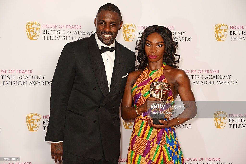 Presenter Idris Elba (L) and Michaela Cole, winner of Best Female Performance In A Comedy Programme for 'Chewing Gum', pose in the winners room at the House Of Fraser British Academy Television Awards 2016 at the Royal Festival Hall on May 8, 2016 in London, England.