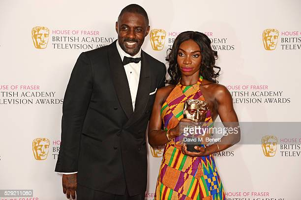 Presenter Idris Elba and Michaela Cole winner of Best Female Performance In A Comedy Programme for 'Chewing Gum' pose in the winners room at the...