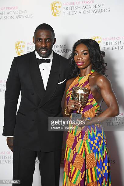 Presenter Idris Elba and Michaela Cole winner of Best Female Performance In A Comedy Programme for 'Chewing Gum' poses in the Winners room at the...
