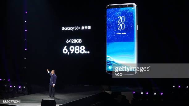A presenter introduces functions of Galaxy S8 smartphone and Galaxy S8 smartphone during the release conference on May 18 2017 in Beijing China...