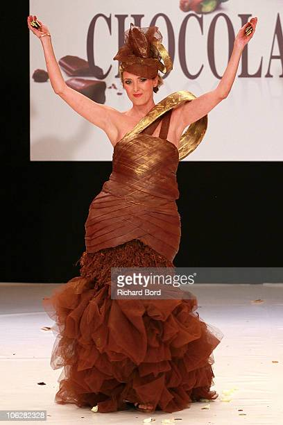 TV presenter Isabelle Bres dressed by Frederic Bau for Valrhona and by Martial Tapolo walks the runway at the Salon Du Chocolat 2010 Opening Night at...