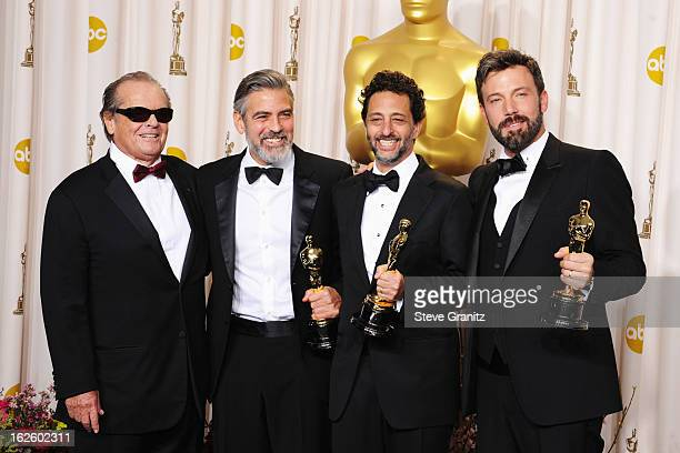 Presenter Jack Nicholson, actor/producer George Clooney, producer George Clooney and actor/producer Ben Affleck pose in the press room during the...