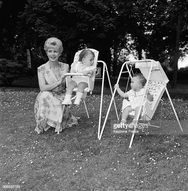 Presenter Jacqueline Huet With Babies Seated In The New Baby Chair Called 'Baby Relax' in France on June 22 1962