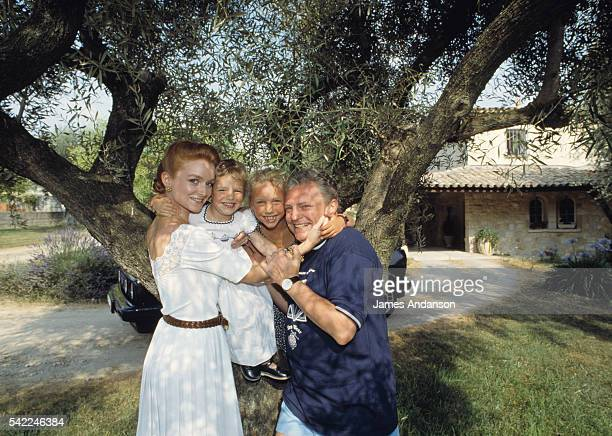 TV presenter Jacques Martin stands outside his home with his wife Celine and his two children JeanneMarie and Judith