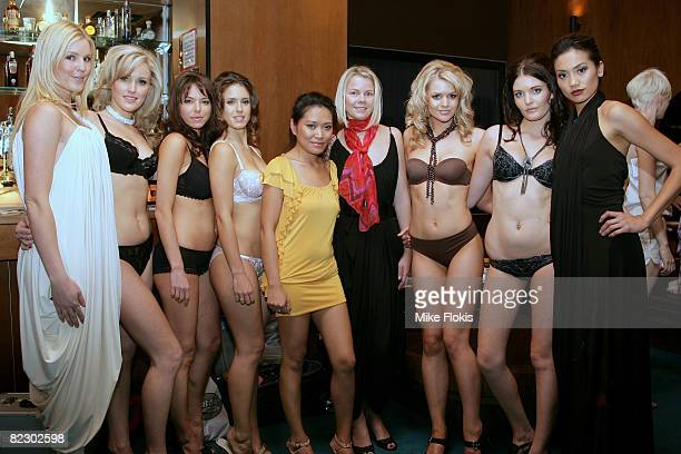 Presenter Jaime Wright poses with models and Designers Pia Gladys Perey and Helene Pilhage prior to the show for designs by White Kitten and Femina's...