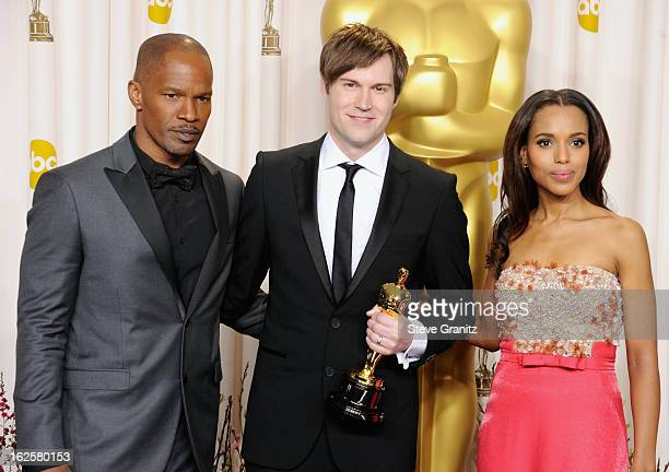 Presenter Jamie Foxx, animator John Kahrs and presenter Kerry Washington pose in the press room during the Oscars at the Loews Hollywood Hotel on...