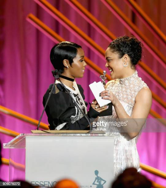 Presenter Janelle Monae and Honoree Tessa Thompson speak onstage during the 2018 Essence Black Women In Hollywood Oscars Luncheon at Regent Beverly...