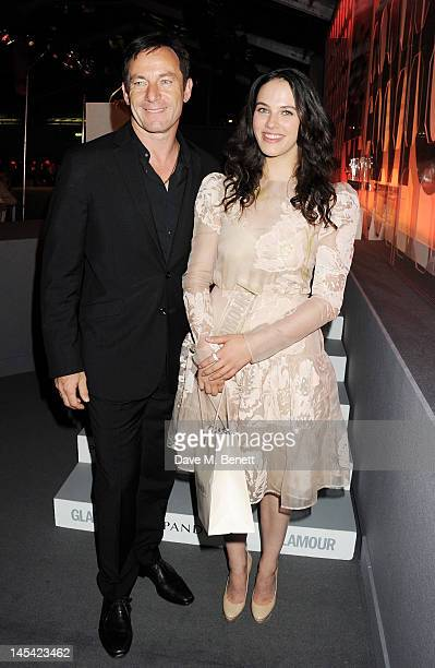 Presenter Jason Isaacs and UK TV Actress Of The Year Jessica Brown Findlay pose at the Glamour Women of the Year Awards in association with Pandora...