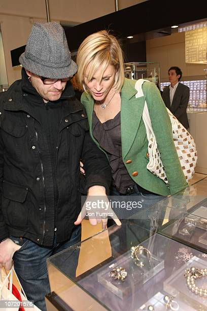 TV presenter Jenni Falconer and her husband actor James Midgley view Swarovski jewellery at the 'Sex And The City 2' DVD Launch Party at the...