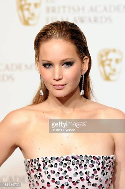 Presenter Jennifer Lawrence poses in the press room at the EE British Academy Film Awards at The Royal Opera House on February 10 2013 in London...