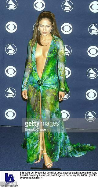 Presenter Jennifer Lopez poses backstage at the 42nd Annual Grammy Awards in Los Angeles February 23, 2000.