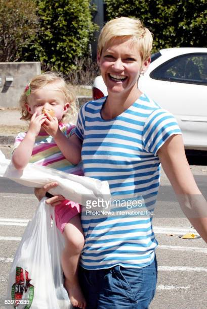 TV Presenter Jessica Rowe walks with her daughter Allegra nearby her Rose Bay home on September 27 2008 in Sydney Australia
