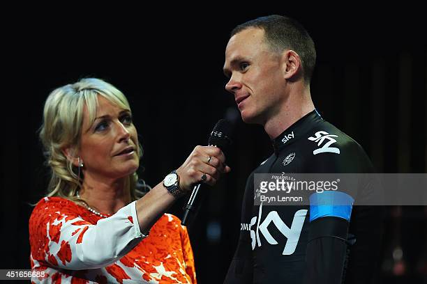 Presenter Jill Douglas chats to defending champion Chris Froome of Great Britain and Team SKY during the 2014 Tour de France Team Presentation prior...
