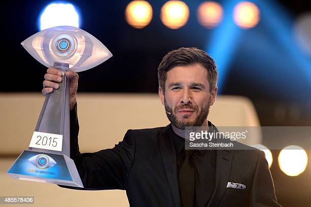 Presenter Jochen Schropp shows the trophy prior to the final show of Promi Big Brother 2015 at MMC studios on August 28 2015 in Cologne Germany