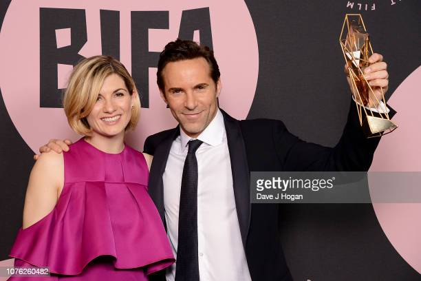 Presenter Jodie Whittaker and winner of the Supporting Actor Award for 'Disobedience' Alessandro Nivola in the winners room at the 21st British...