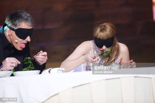 Presenter Joerg Pilawa and Swiss singer Francine Jordi eating blindfolded at the final rehersal for the Silvestershow in GrazAustria 30 December...