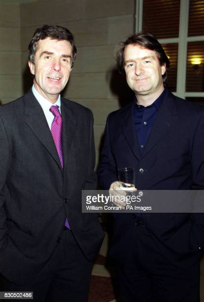 GMTV presenter John Stapleton with chief correspondent Martin Frizell at the breakfast TV show's Christmas Party held at the Atrium central London