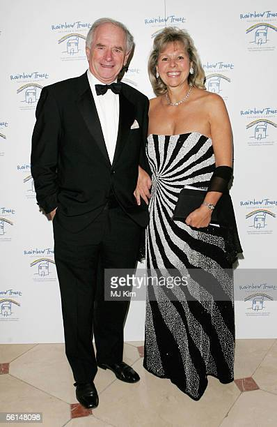 TV presenter Johnny Ball and guest attend the Rainbow Glass Slipper Ball 2005 at the London Hilton Park Lane on November 12 2005 in London England...