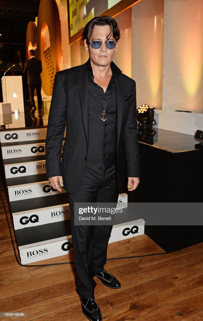 Presenter Johnny Depp attends the GQ Men Of The Year awards in association with Hugo Boss at The Royal Opera House on September 2, 2014 in London, England.