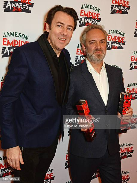 "Presenter Jonathan Ross and Sam Mendes pose in the winners room with the Best British Film award for ""Spectre"" at the Jameson Empire Awards 2016 at..."