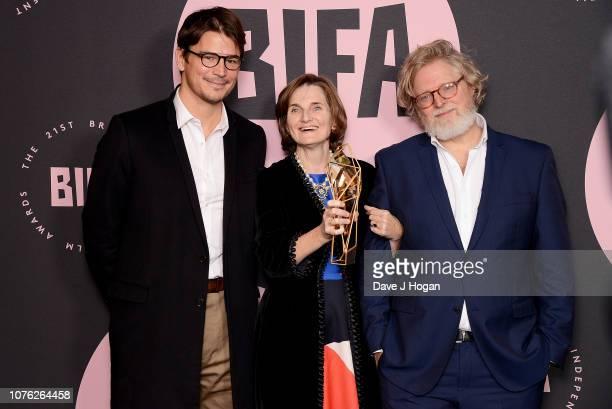 Presenter Josh Hartnett and winners of the Best Screenplay Award for 'The Favourite' Deborah Davis and Tony McNamara in the winners room at the 21st...