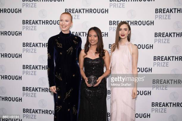Presenter Julia Milner award winner Hillary Diane A Andales and presenter Lily Collins pose for photos after award ceremony at the 2018 Breakthrough...
