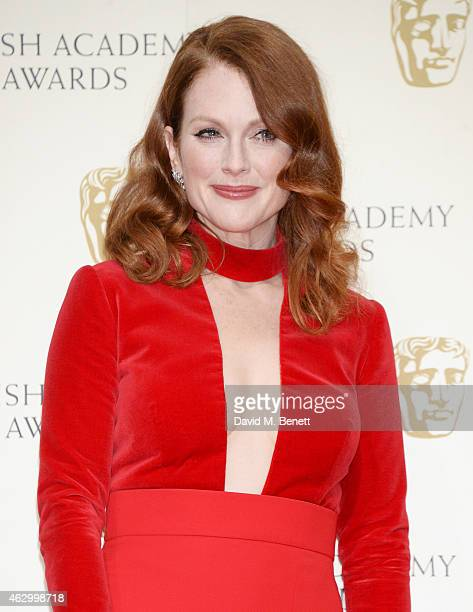 Presenter Julianne Moore poses in the winners room at the EE British Academy Film Awards at The Royal Opera House on February 8 2015 in London England