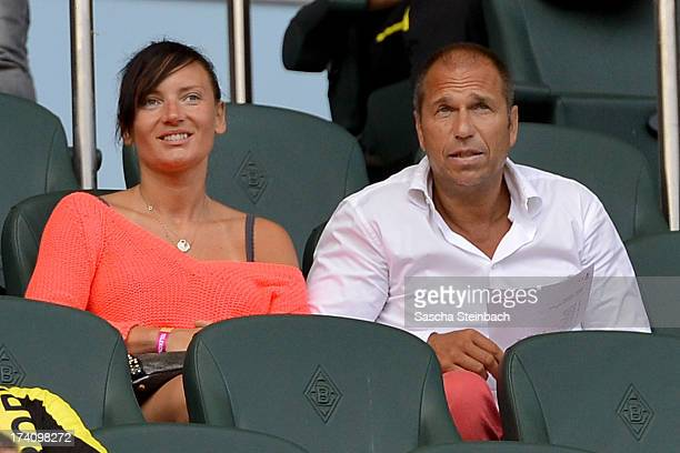 Presenter Kai Ebel and his girl friend Milla Wiegand look on during the Telekom Cup 2013 match between Borussia Moenchengladbach and Borussia...