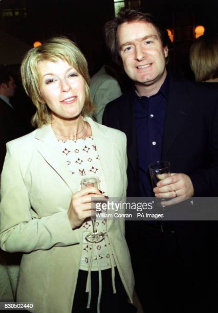 GMTV presenter Kate Garraway with chief correspondent Martin Frizell at the breakfast TV show's Christmas Party held at the Atrium central London