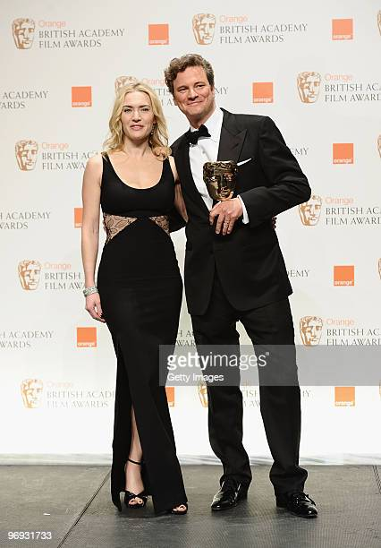 Presenter Kate Winslet and winner Colin Firth pose with his award for Leading Actor for the film A Single Man during the Orange British Academy Film...