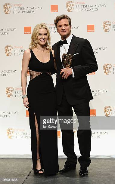Presenter Kate Winslet and winner Colin Firth pose with the award for Leading Actor for the film A Single Man during the Orange British Academy Film...