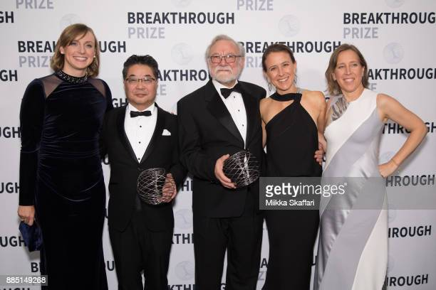 Presenter Katie Ledecky award winners Dr Kazutoshi Mori and Dr Peter Walter and presenters Anne Wojcicki and Susan Wojcicki pose for photos after...