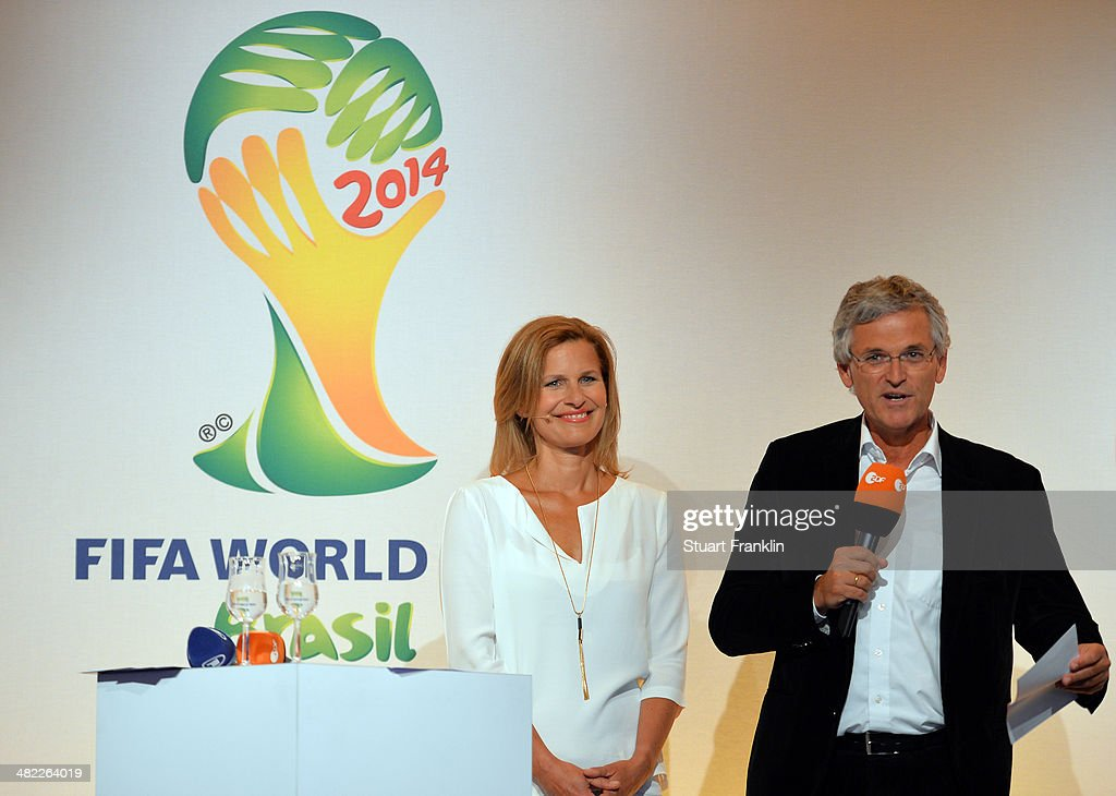 ZDF presenter Katrin Müller-Hohenstein and Doctor Peter Frey, Chief editor of ZDF are pictured during the ARD/ZDF FIFA World Cup 2014 team presentation event on April 3, 2014 in Hamburg, Germany.